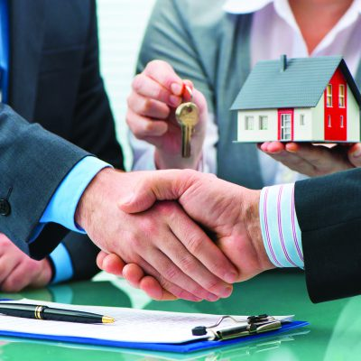 52325961 - estate agent shaking hands with customer after contract signature